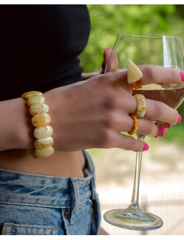 Balls earrings with amber photo. Yellow sparkling amber